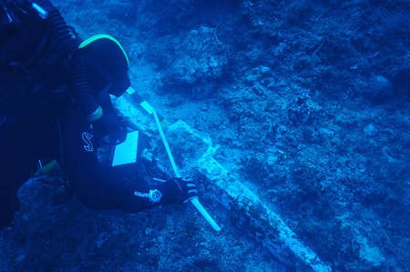 New international mission ready to explore Antikythera shipwreck - Archaeology Theotokis Theodoulou examines the ship's lead anchor stock, about 1.4 metres long and weighing close to 200kg