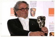 George Miller holds the Award for Animated Feature Film for Happy Feet at BAFTA.
