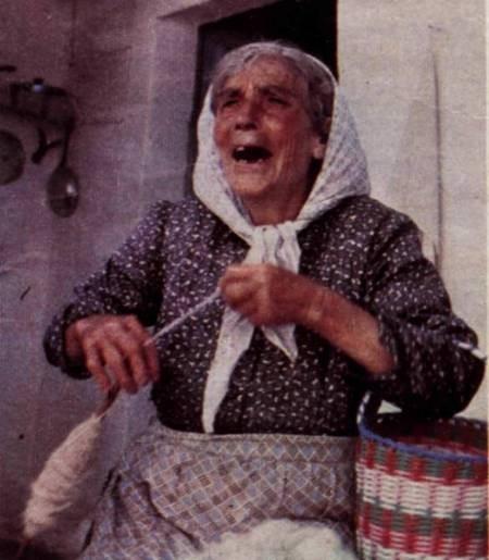 Mrs Erofeli Psaltis (1976) strands raw wool on a bobbin...