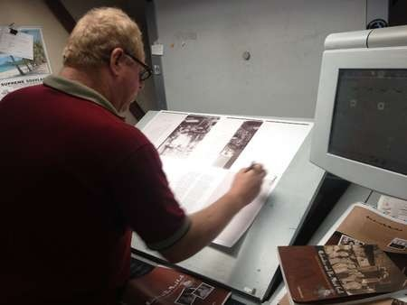 KWHF's Australian printer checking the print run sheets for Aphrodite and the Mixed Grill