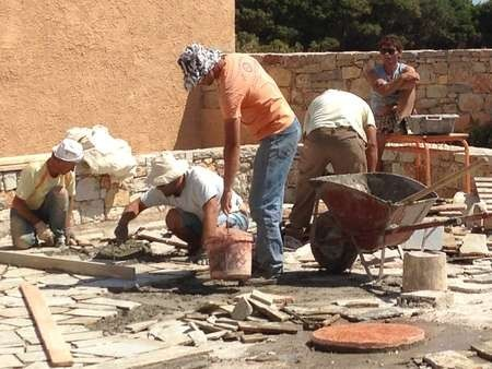"Laying the ""coritzo'' tiles in the courtyard of the Kytherian Municipal Library 2"