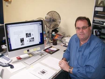 Mark Drolc, graphic designer, working on the book Life in Australia
