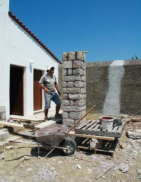 Grammos re-building the piers for the pergola in the courtyard of the Kythera Municipal Library