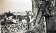 Workmen repairing the wall at Papoo's house