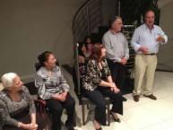 Logothetiani listen attentively as Theothori Koukoulis delivers a speech