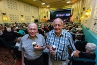 "Spiro and Angelo Notaras eating ice cream at "" The Proms"" concert the Saraton Theatre ."