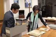 Bon Koizumi and wife Shoko Koizumi examining the exhibits in New Orleans