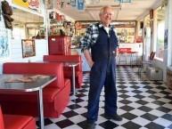 Cyril Robinson inside his milk bar