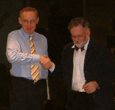 Peter Prineas presents Bob Carr with a gift of his book Wild Places.