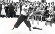 strong man bending steel