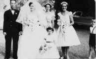 Voula Logus (nee, Coroneos) on her wedding day, with attendants.