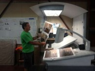 George C Poulos checks the results of the printed cover for Aphrodite and the Mixed Grill