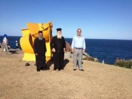 The Metropoliti of Kythera and Father Petros in front of one of the many sculptures