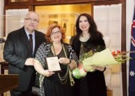 Maria Hill presented with an award by the Greek Ambassador Charalambos Dafaranos and his wife Eva