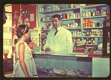 Bretos Margetis serving in Redfern Pharmacy.