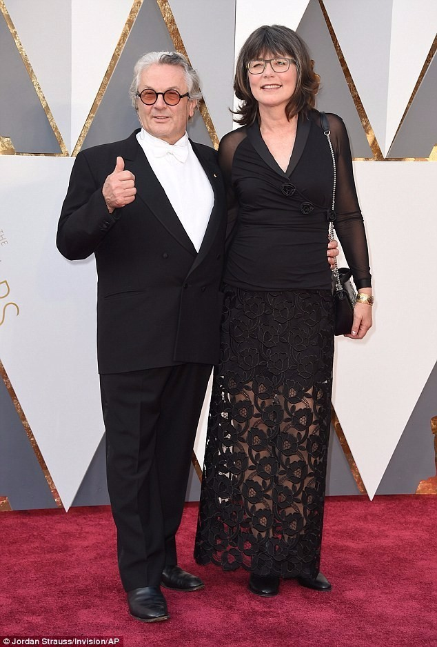 Mad Max director George Miller gives a cheery thumbs up as he arrives at the Oscars with wife Margaret Sixel after his film is nominated for ten gongs