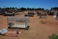 Ollie Constandinou (Tzortzo)Poulos. Her gravesite in relationship to the childs cot gravesite.
