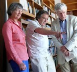 John Stathatos introducing Professor and Mrs George Huxley to the library during the course of their August 2013 visit to the island.