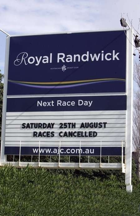 A sign informs punters of the cancellation of the Royal Randwick meeting due to the equine influenza outbreak