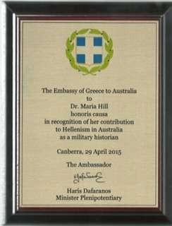 The Award presented to Maria Hill by the Greek Ambassador Charalambos Dafaranos and his wife Eva