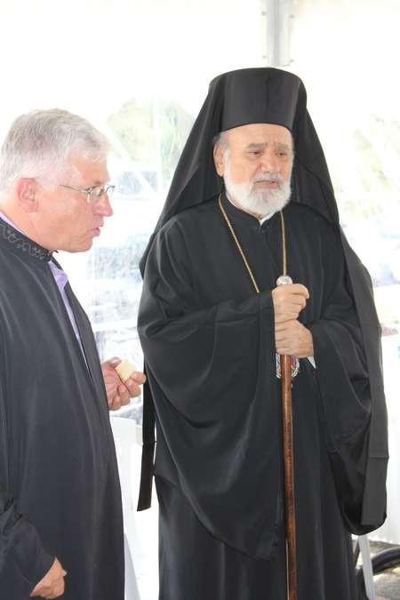 His Grace Bishop Seraphim, administering Holy Communion - 03 Saint Harry 3