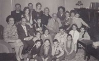 George Lianos surrounded by children and grandchildren