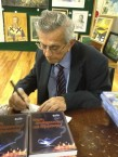 Jim Saltis signing copies at the launch of his latest book Ευχές αναθεματισμοί και εξορκισμοί