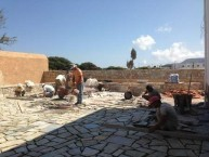 "Laying the ""coritzo'' tiles in the courtyard of the Kytherian Municipal Library"