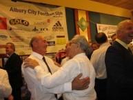 Spyro Calocerinos embraces Nick Andronikos