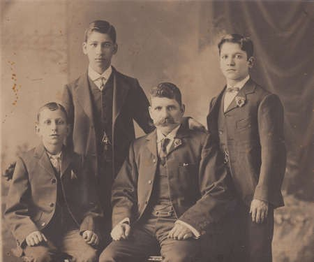 George Margetis, with his sons, left to right, Minas, Bretos, and Jim
