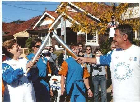 Nicholas (Nick) George Politis - RITA COMINO HANDS OVER OLYMPIC FLAME TO NICK POLITIS IN BAY STREET BRIGHTON LE SANDS JUNE 4 2004. SYDNEY AUSTRALIA